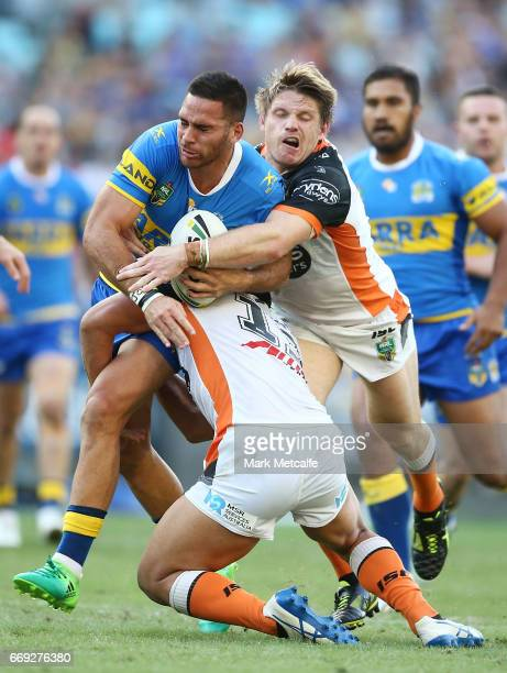 Corey Norman of the Eels is tackled by Chris Lawrence of the Tigers during the round seven NRL match between the Parramatta Eels and the Wests Tigers...
