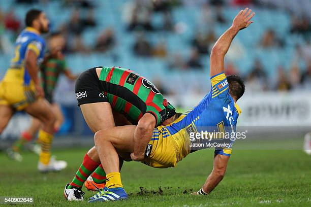 Corey Norman of the Eels is tackled by Sam Burgess of the Rabbitohs during the round 15 NRL match between the South Sydney Rabbitohs and the...