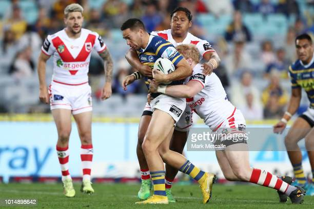 Corey Norman of the Eels is tackled during the round 22 NRL match between the Parramatta Eels and the St George Illawarra Dragons at ANZ Stadium on...
