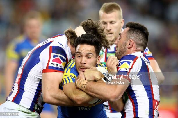 Corey Norman of the Eels is tackled during the round 23 NRL match between the Parramatta Eels and the Newcastle Knights at ANZ Stadium on August 11...