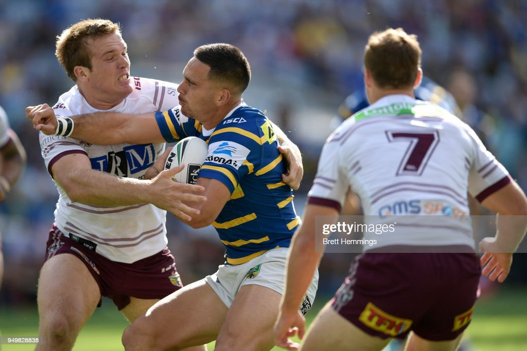 Corey Norman of the Eels is tackled during the round seven NRL match between the Parramatta Eels and the Manly Sea Eagles at ANZ Stadium on April 22, 2018 in Sydney, Australia.