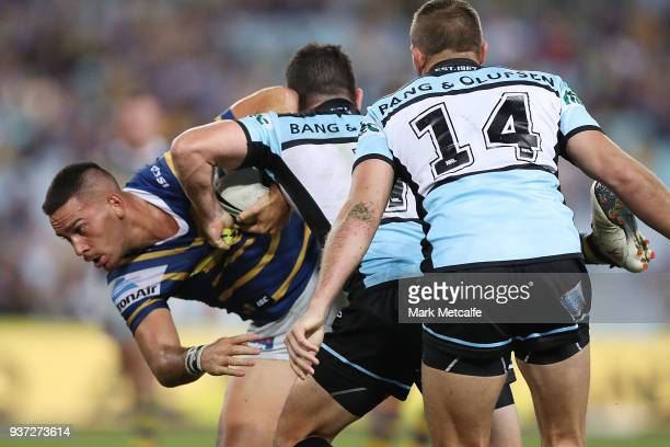 Corey Norman of the Eels is tackled during the round three NRL match between the Parramatta Eels and the Cronulla Sharks at ANZ Stadium on March 24...