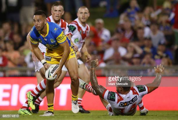 Corey Norman of the Eels is tackled during the round two NRL match between the St George Illawarra Dragons and the Parramatta Eels at WIN Stadium on...