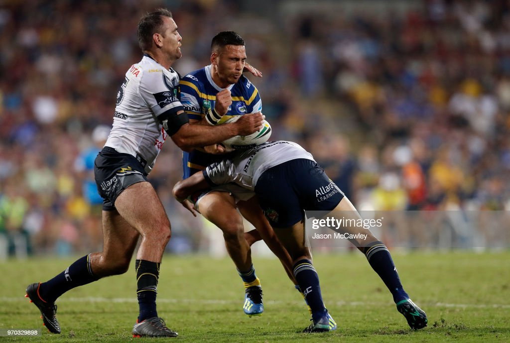 Corey Norman of the Eels is tackled Kane Linnett of the Cowboys during the round 14 NRL match between the Parramatta Eels and the North Queensland Cowboys at TIO Stadium on June 9, 2018 in Darwin, Australia.