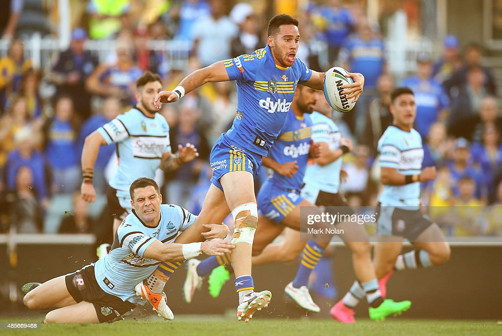 Corey Norman of the Eels makes a line break during the round 25 NRL match between the Parramatta Eels and the Cronulla Sharks at Pirtek Stadium on August 29, 2015 in Sydney, Australia.