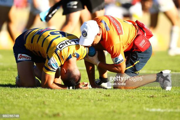 Corey Norman of the Eels receives attention from the trainer during the round one NRL match between the Penrith Panthers and the Parramatta Eels at...