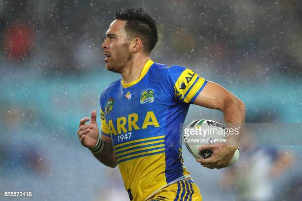 Corey Norman of the Eels runs the ball during the round 22 NRL match between the Canterbury Bulldogs and the Parramatta Eels at ANZ Stadium on August...