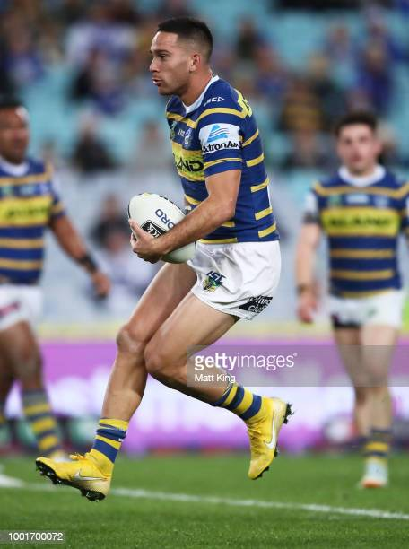 Corey Norman of the Eels runs with the ball during the round 19 NRL match between the Parramatta Eels and the Canterbury Bulldogs at ANZ Stadium on...