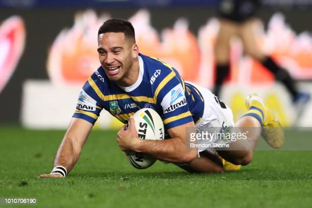 Corey Norman of the Eels scores a try during the round 21 NRL match between the Parramatta Eels and the Gold Coast Titans at ANZ Stadium on August 4...