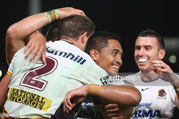 Corey Oates Anthony Milford and Darius Boyd of the Broncos celebrate a try only to have it disallowed during the round one NRL match between the...