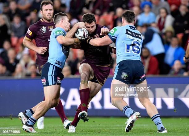 Corey Oates of Queensland takes on the defence during game three of the State of Origin series between the Queensland Maroons and the New South Wales...