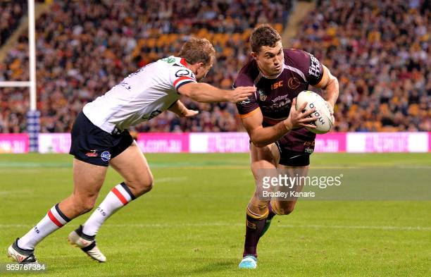 Corey Oates of the Broncos breaks away from the defence during the round 11 NRL match between the Brisbane Broncos and the Sydney Roosters at Suncorp...