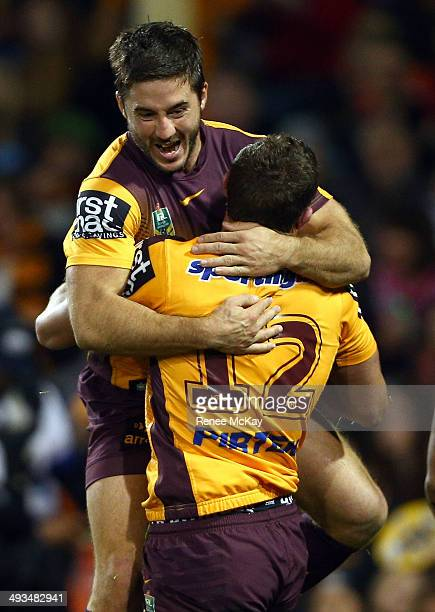 Corey Oates of the Broncos celebrates his try with Ben Hunt during the round 11 NRL match between the Wests Tigers and the Brisbane Broncos at...