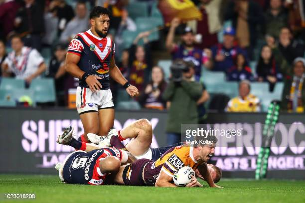 Corey Oates of the Broncos celebrates scoring a try during the round 24 NRL match between the Sydney Roosters and the Brisbane Broncos at Allianz...