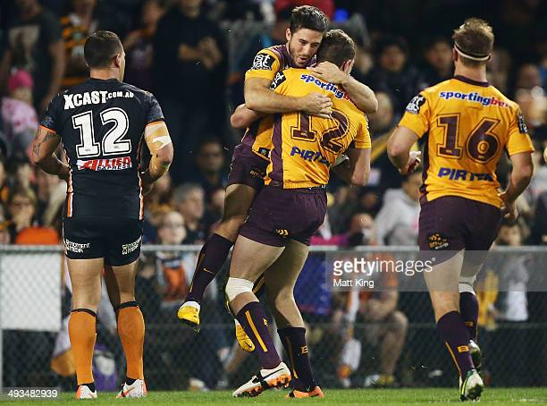 Corey Oates of the Broncos celebrates with Ben Hunt after scoring a try during the round 11 NRL match between the Wests Tigers and the Brisbane...