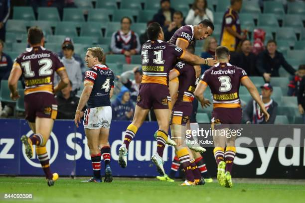 Corey Oates of the Broncos celebrates with his team mates after scoring a try during the NRL Qualifying Final match between the Sydney Roosters and...