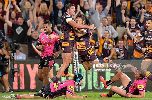 Corey Oates of the Broncos celebrates with team mates after scoring the match winning try during the round nine NRL match between the Brisbane...