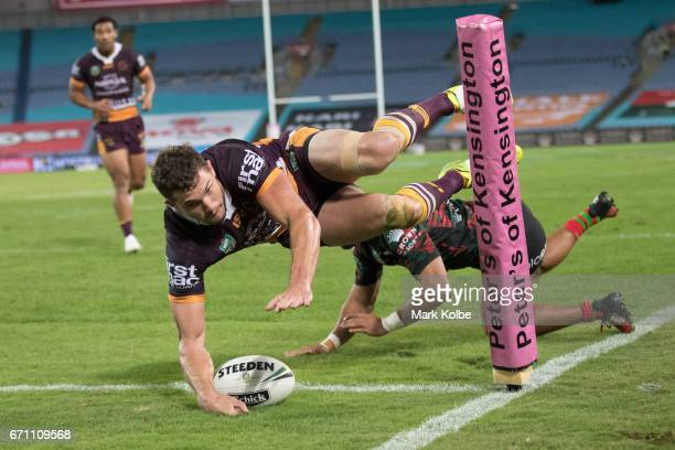 Corey Oates of the Broncos dives in to score a try during the round eight NRL match between the South Sydney Rabbitohs and the Brisbane Broncos at...