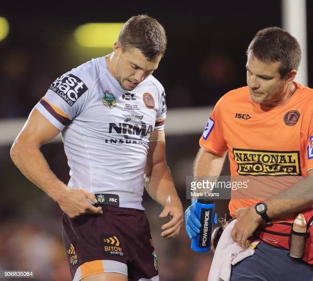 Corey Oates of the Broncos goes off the field with a hip injury during the round three NRL match between the Wests Tigers and the Brisbane Broncos at...