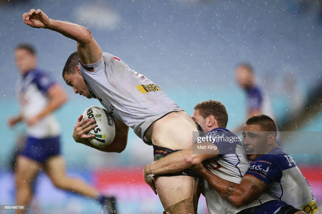 Corey Oates of the Broncos is tackled by Brenko Lee of the Bulldogs during the round five NRL match between the Canterbury Bulldogs and the Brisbane Broncos at ANZ Stadium on March 30, 2017 in Sydney, Australia.