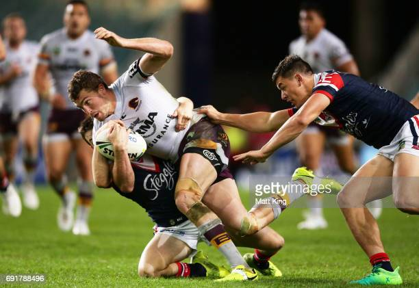Corey Oates of the Broncos is tackled during the round 13 NRL match between the Sydney Roosters and the Brisbane Broncos at Allianz Stadium on June 3...