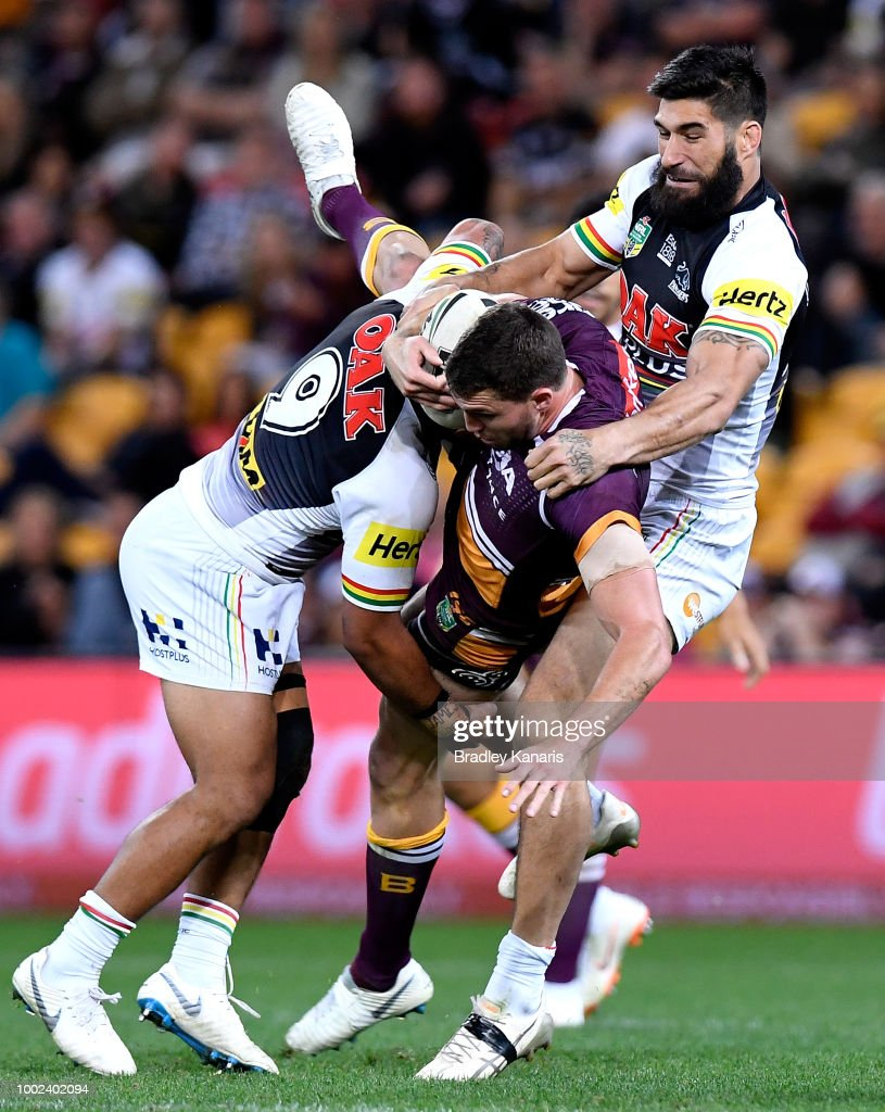 Corey Oates of the Broncos is tackled during the round 19 NRL match between the Brisbane Broncos and the Penrith Panthers at Suncorp Stadium on July 20, 2018 in Brisbane, Australia.