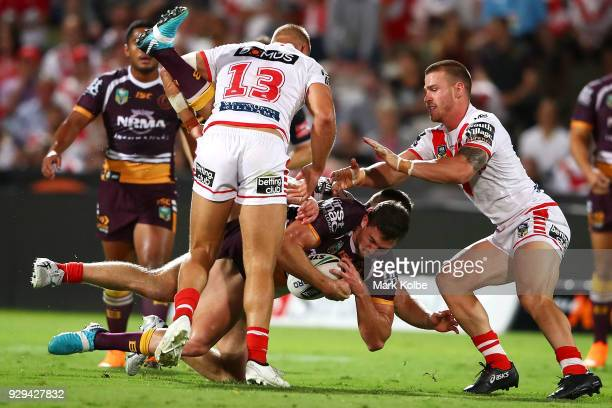 Corey Oates of the Broncos is tackled during the round one NRL match between the St George Illawarra Dragons and the Brisbane Broncos at UOW Jubilee...