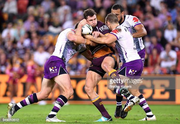 Corey Oates of the Broncos is tackled during the round seven NRL match between the Brisbane Broncos and the Melbourne Storm at Suncorp Stadium on...