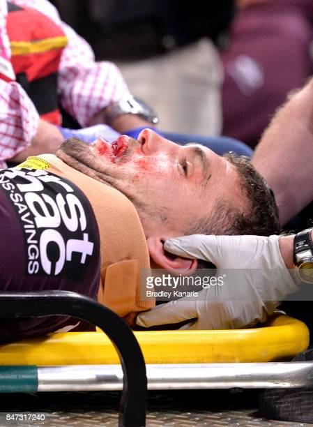 Corey Oates of the Broncos is taken from the field injured during the NRL Semi Final match between the Brisbane Broncos and the Penrith Panthers at...