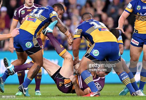 Corey Oates of the Broncos is upended in the tackle during the round 12 NRL match between the Brisbane Broncos and the Parramatta Eels at Suncorp...