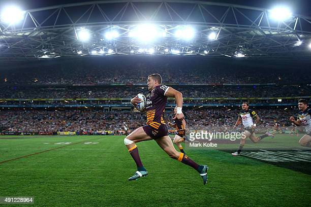 Corey Oates of the Broncos makes a break to score a try during the 2015 NRL Grand Final match between the Brisbane Broncos and the North Queensland...