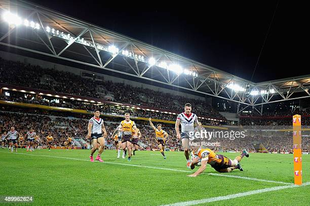 Corey Oates of the Broncos scores a try during the NRL First Preliminary Final match between the Brisbane Broncos and the Sydney Roosters at Suncorp...