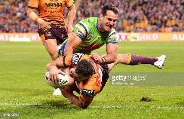 Corey Oates of the Broncos scores a try during the round 16 NRL match between the Brisbane Broncos and the Canberra Raiders at Suncorp Stadium on...