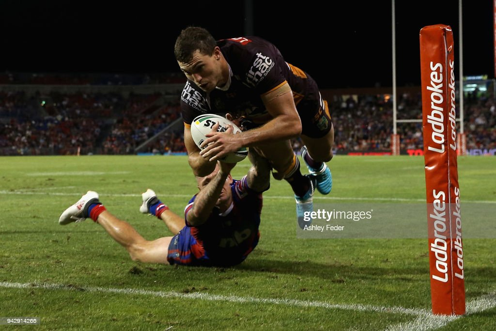 Corey Oates of the Broncos scores a try tackled by Shaun Kenny-Dowall of the Knights during the round five NRL match between the Newcastle Knights and the Brisbane Broncos at McDonald Jones Stadium on April 7, 2018 in Newcastle, Australia.