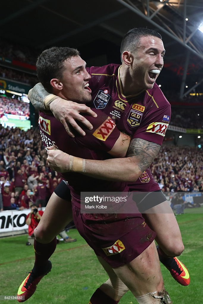 Corey Oates of the Maroons celebrates with his team mate Darius Boyd of the Maroons after scoring a try during game two of the State Of Origin series between the Queensland Maroons and the New South Wales Blues at Suncorp Stadium on June 22, 2016 in Brisbane, Australia.