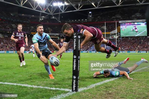 Corey Oates of the Maroons dives over in the corner to score a try during game one of the 2019 State of Origin series between the Queensland Maroons...