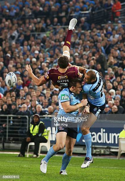Corey Oates of the Maroons goes up for a high ball next to Josh Morris and Blake Ferguson of the Blues during game one of the State Of Origin series...