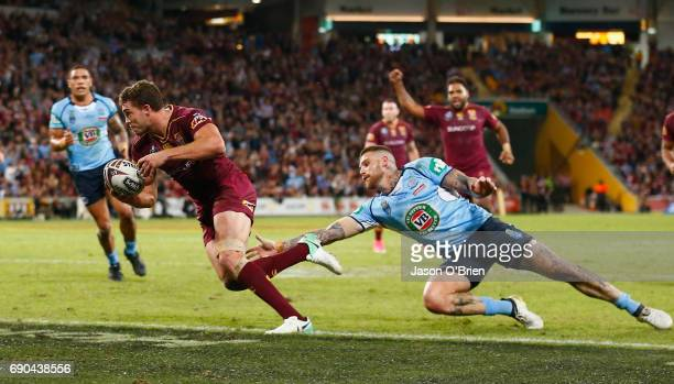 Corey Oates of the Maroons scores a try during game one of the State Of Origin series between the Queensland Maroons and the New South Wales Blues at...