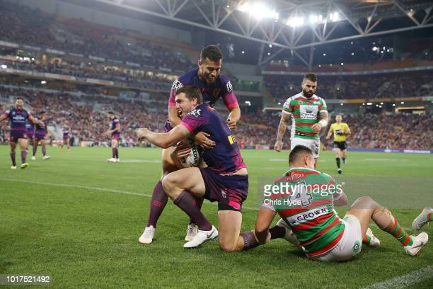 Corey Oats of the Broncos celebrates a try during the round 23 NRL match between the Brisbane Broncos and the South Sydney Rabbitohs at Suncorp...