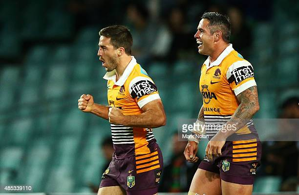 Corey Parker and Ben Hunt of the Broncos celebrate a try by Hunt during the round 25 NRL match between the South Sydney Rabbitohs and the Brisbane...