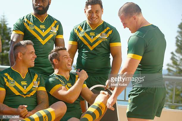 Corey Parker and Cooper Cronk share a joke with Paul Gallen as they ste up for the team photo during the Australia Kangaroos Test team photo session...