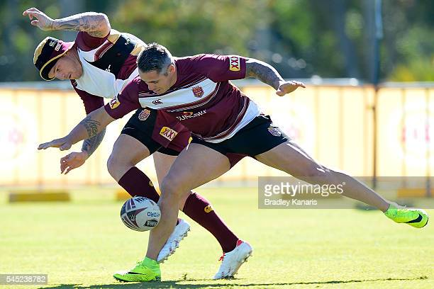 Corey Parker and Josh McGuire compete for the ball during a Queensland Maroons State of Origin training session at Sanctuary Cove on July 7 2016 in...