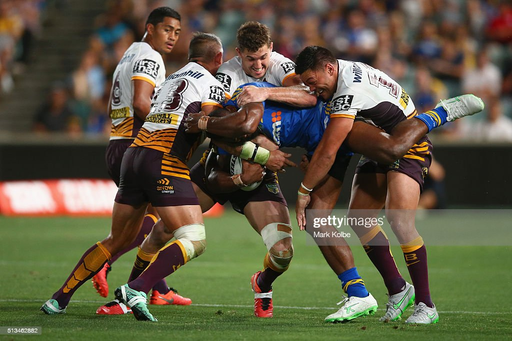 Corey Parker, Corey Oates and Alex Glenn of the Broncos tackle Semi Radradra of the Eels during the round one NRL match between the Parramatta Eels and the Brisbane Broncos at Pirtek Stadium on March 3, 2016 in Sydney, Australia.