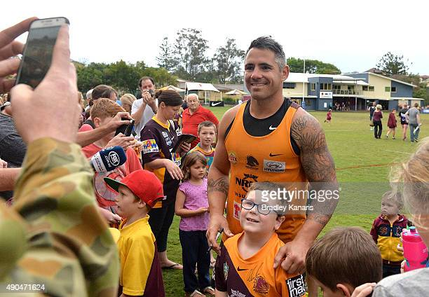 Corey Parker is swamped by fans during the Brisbane Broncos NRL training session on September 29 2015 in Brisbane Australia