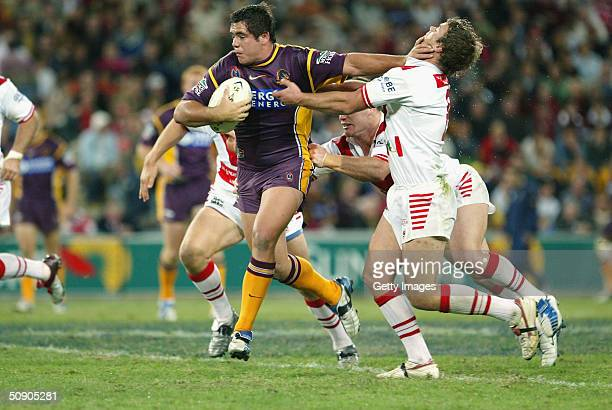 Corey Parker is tackled during the NRL match between the Brisbane Broncos and St George Illawara Dragons played at Suncorp Stadium on May 28 2004 in...