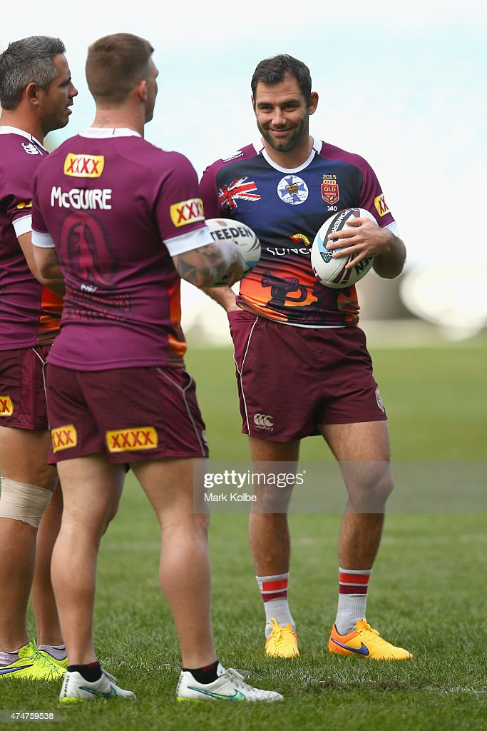 Corey Parker, Josh McGuire and Cameron Smith speak during a Queensland Maroons State of Origin training session at ANZ Stadium on May 26, 2015 in Sydney, Australia.