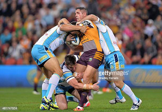 Corey Parker of the Broncos attempts to break free from the defence during the round 20 NRL match between the Brisbane Broncos and the Gold Coast...