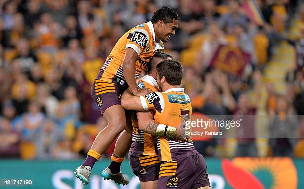 Corey Parker of the Broncos celebrates scoring a try with team mates Ben Hunt and Anthony Milford during the round 20 NRL match between the Brisbane...