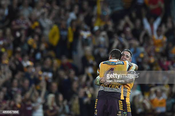Corey Parker of the Broncos celebrates victory with Justin Hodges during the NRL First Preliminary Final match between the Brisbane Broncos and the...