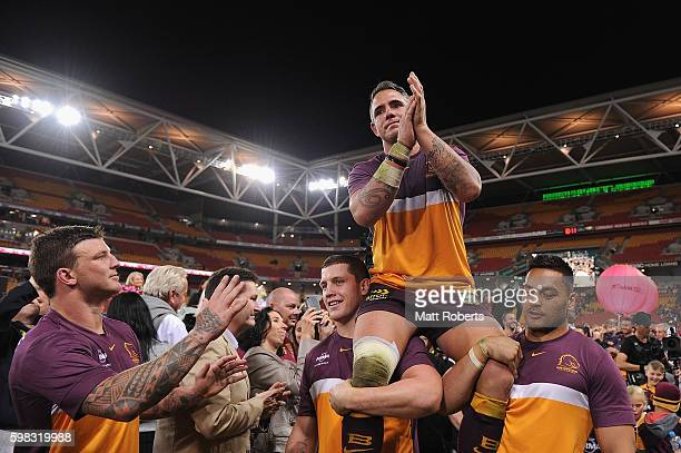 Corey Parker of the Broncos is chaired off the field during the round 26 NRL match between the Brisbane Broncos and the Sydney Roosters at Suncorp...
